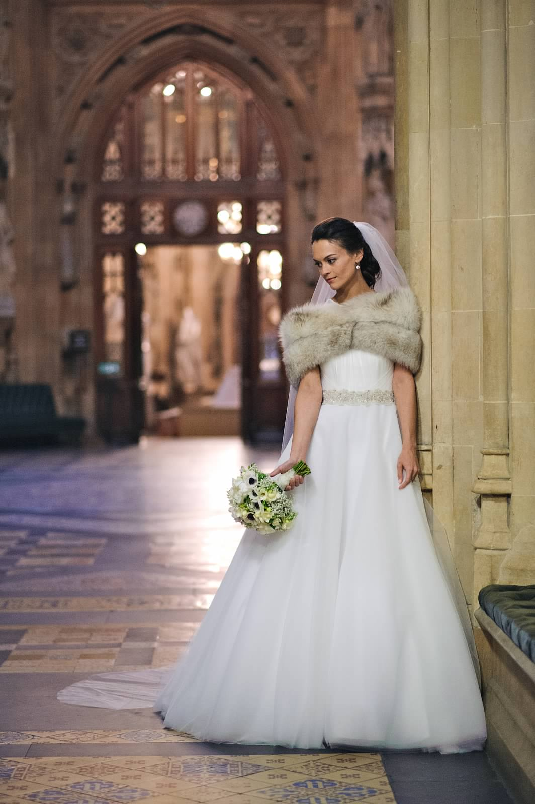 wedding dress. wedding makeup and bridal hair in a soft low bun hairstyle. By Pam Wrigley wedding makeup artist and bridal hair stylist, Westminster Abbey London.
