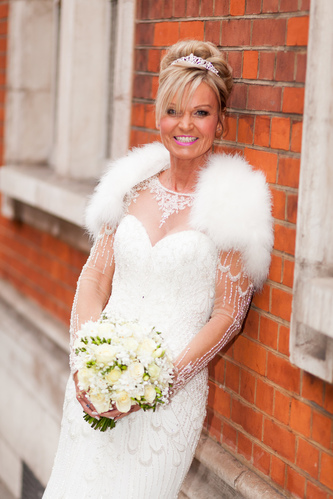 wedding photos. mature brides. smokey makeup for mature bride by wedding makeup artist Pam Wrigley. Plus a beautiful brides hair up, high bun hairstyle created on long hair by bridal hairstylist Pam Wrigley, in London