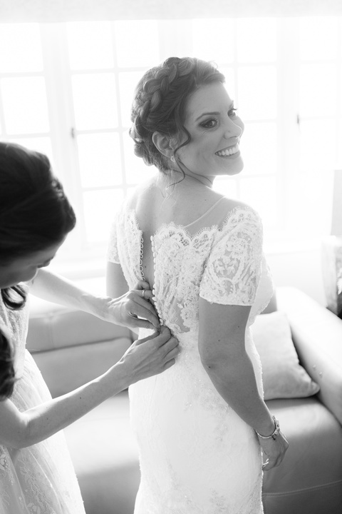 wedding and bridal hairstylist, creating a hair up low bun in London. Beautiful natural makeup created by makeup artist Pam Wrigley. This is a bridal braided hair style with a flower crown in Berkshire.