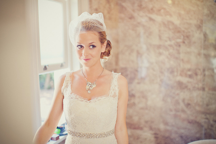 Wedding natural vintage makeup and bridal hair in a low bun hairstyle for a bride. By Pam Wrigley wedding makeup artist and bridal hair stylist, London.