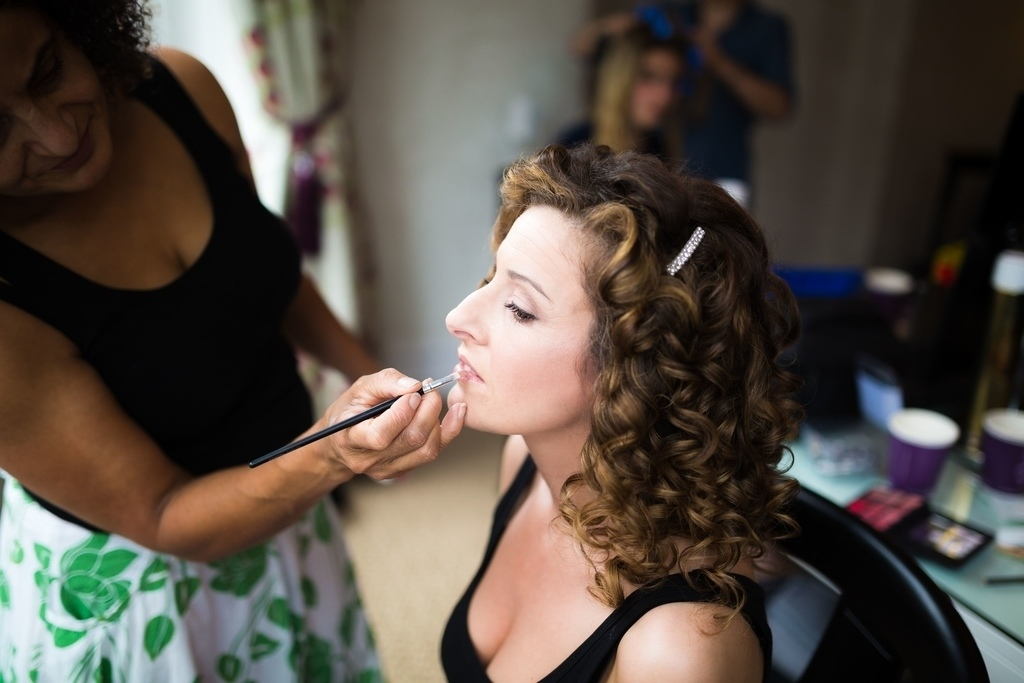 trial run. Bridal makeup for a bride, plus bridal hairstyles for brides with long, thick, heavy hair with natural curls by wedding makeup artist and bridal hair stylist Pam Wrigley at the St Ermin Hotel