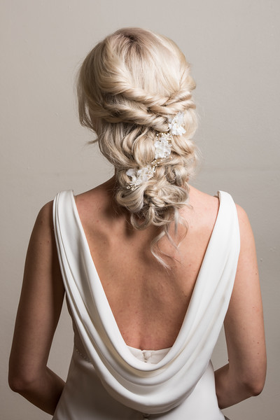 bridal hairstyle hair up low bun wedding summer wedding