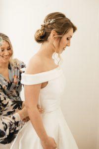 soft smoky bridal wedding makeup and hair by Pam Wrigley London Surrey individual lashes lash extensions soft low bridal bun hairstyle