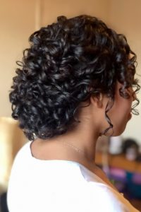 bridal and wedding hairstyles for medium length naturally curly hair, keep your natural curls for your wedding day low bun hairstyle Pam Wrigley