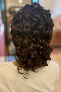 bridal and wedding hairstyles for medium length naturally curly hair, keep your natural curls for your wedding day low bun hairstyle