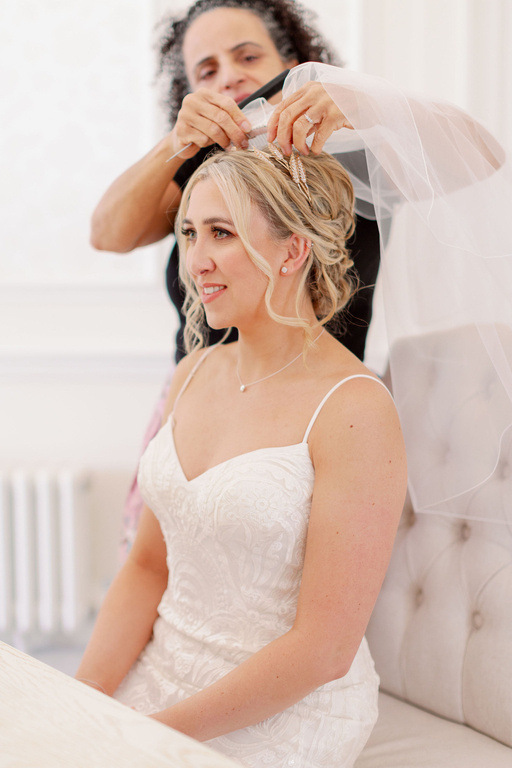 bridal low bun hair styles and wedding hairstyle and bride hair by Pam Wrigley at Hedsor House