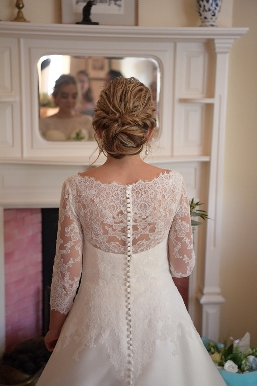 soft relaxed bridal and wedding hairstyles and low bun with braids chiswick london