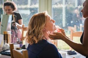 wedding makeup and bridal hairstyliing by Akua Amankona London bride and bridesmaid braids and low bun hair style